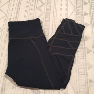 Athleta crops with mesh cross detailing